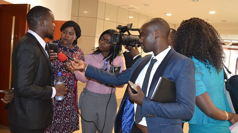 Douglas Banda speaks to the media